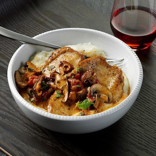 Chicken with Mushrooms, Tomatoes, and Capers over Garlic Grits